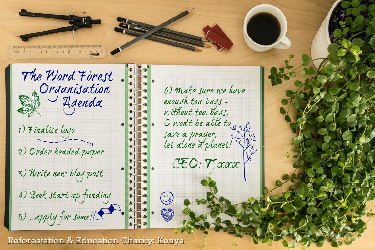 Notepad with meeting agenda for Word Forest Organisation