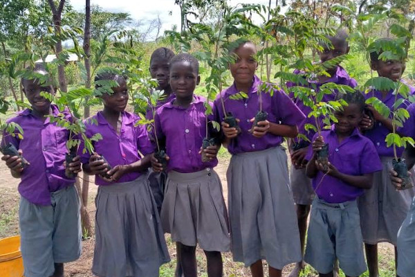 Children planting trees with The Word Forest Organisation