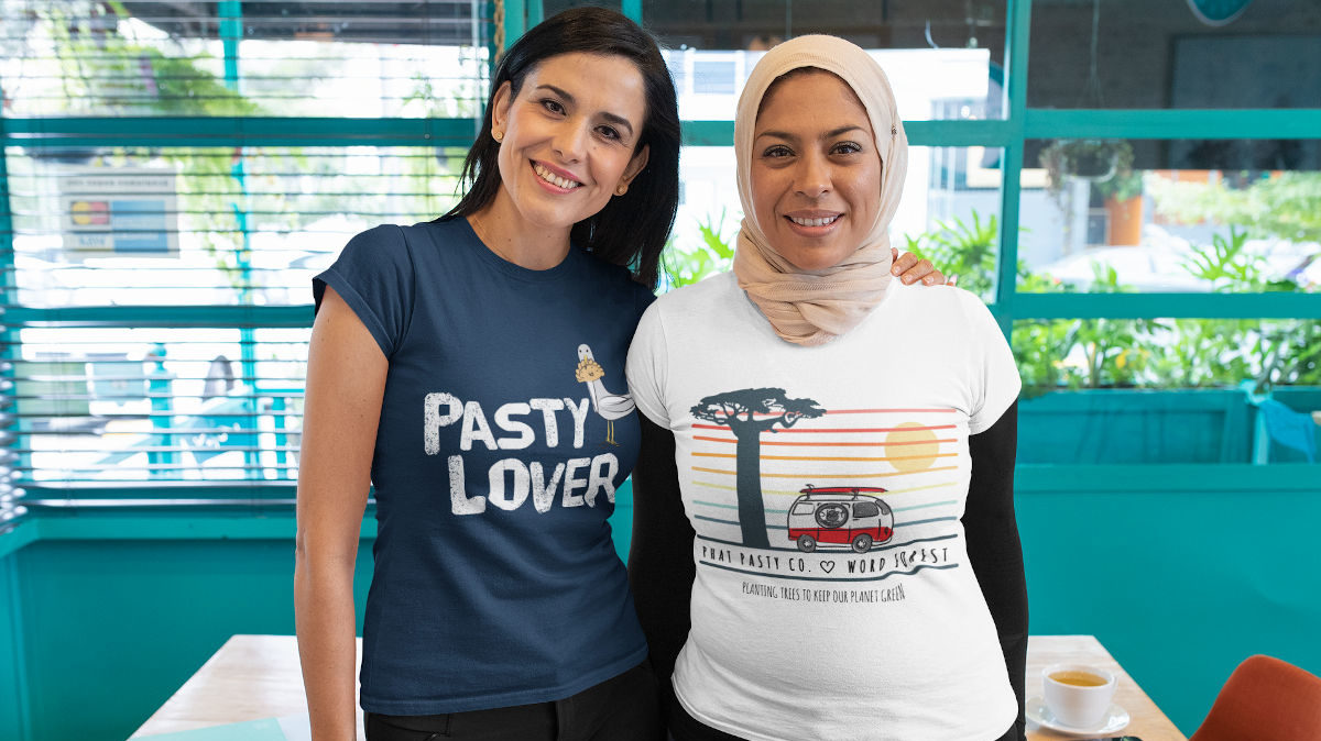 Two adult women wearing Phat Pasty tee shirts