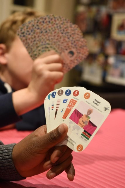Two children playing a Diversity Deck game