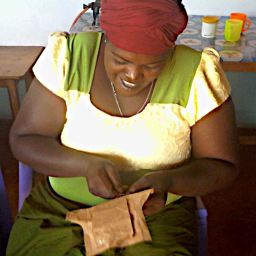 Kenyan woman making a sanitary pad