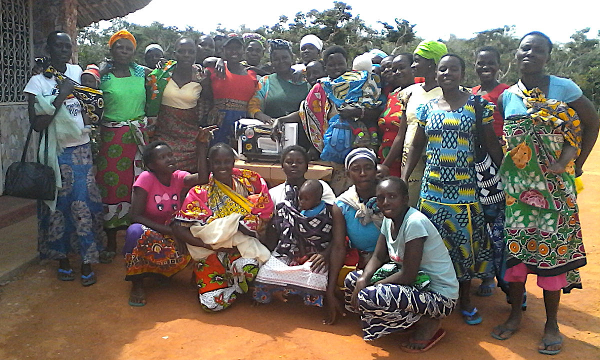 Mothers of the Forest with a sewing machine