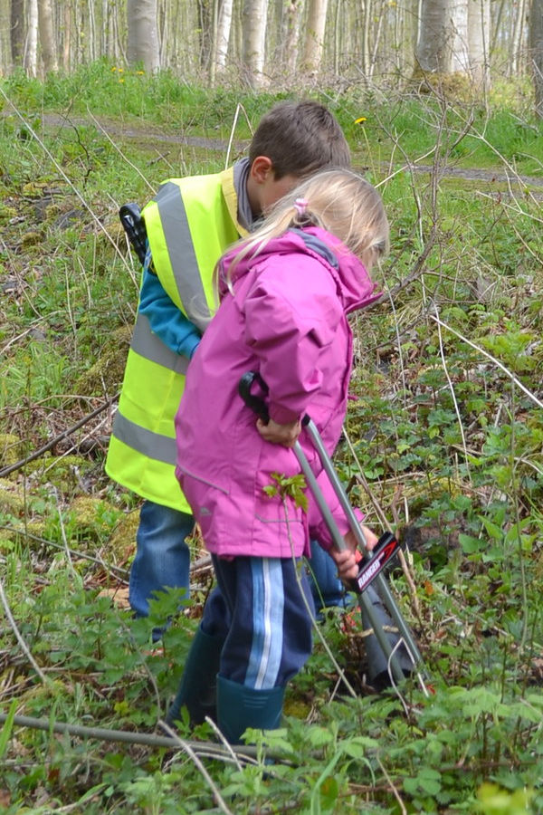 Two children litter picking