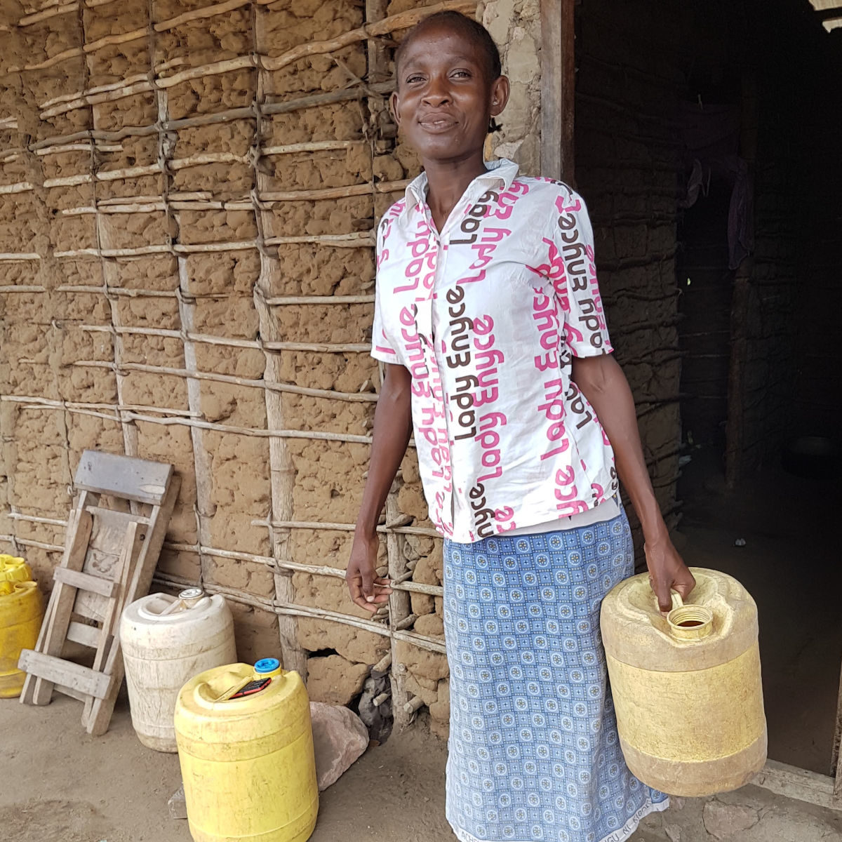 Woman carrying 20l water container