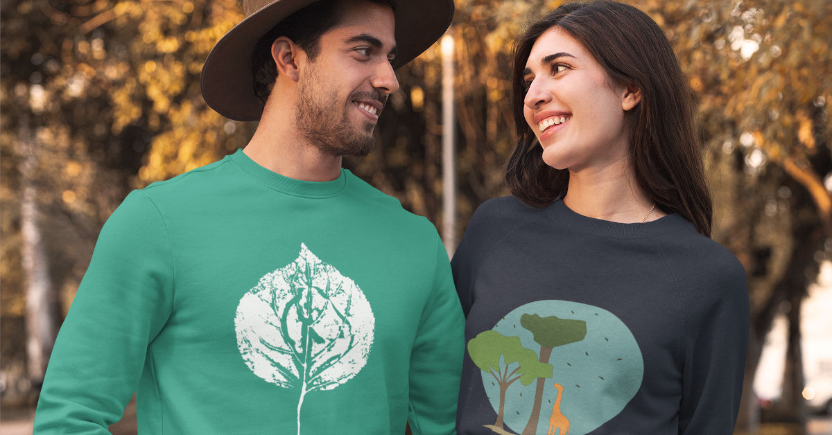 Couple wearing TWFO hoodies in a forest