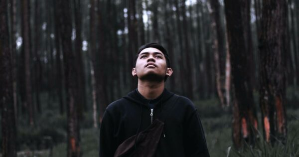 a man in the forest by Eris Setiawan on Unsplash