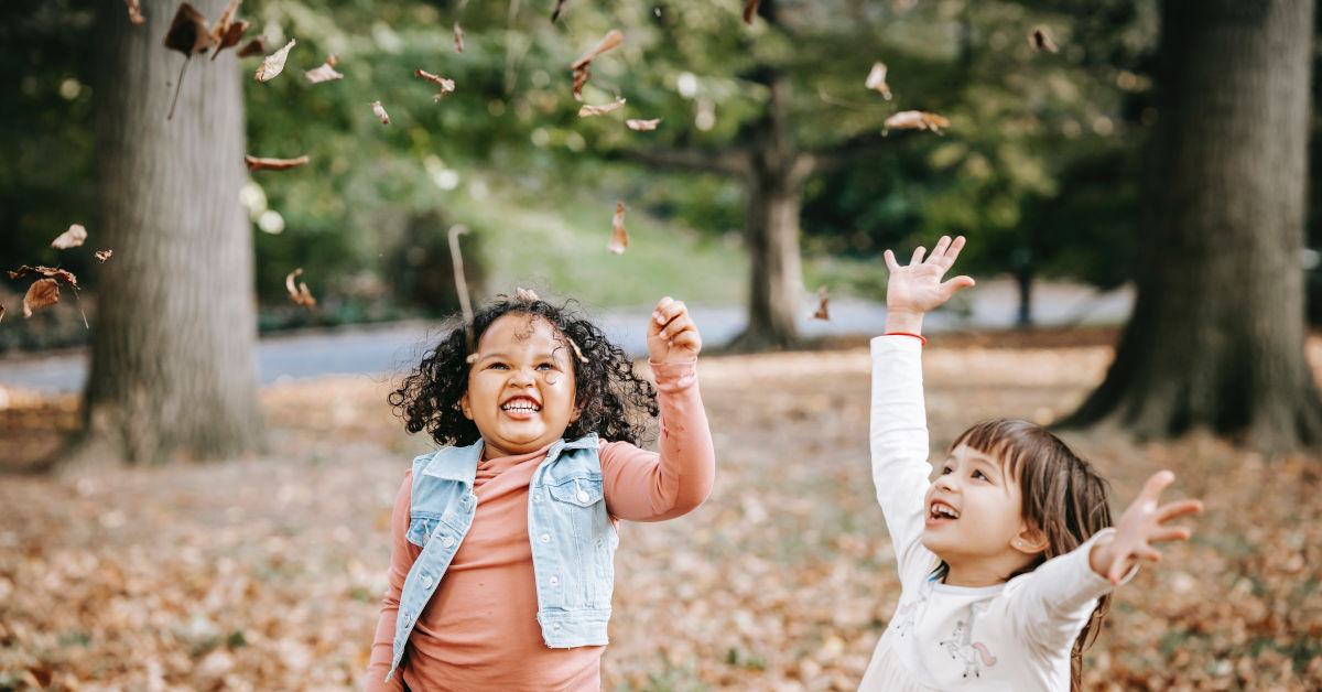 Excited children tossing leaves in park by Charles Parker on Pexels