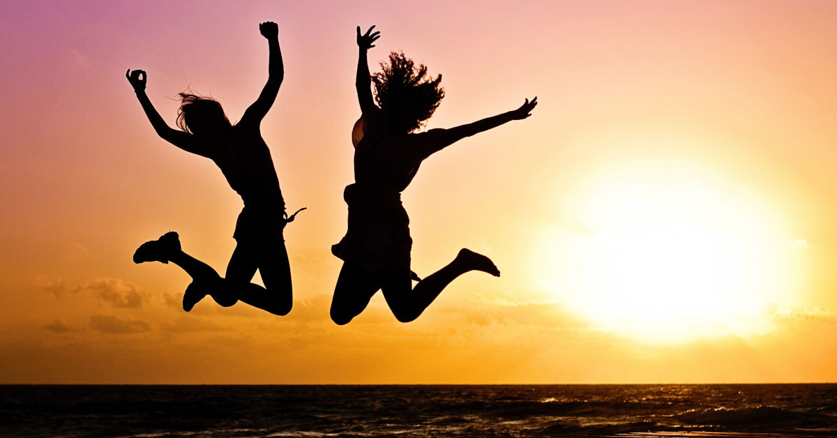Two people jumping by Jill Wellington of Pexels