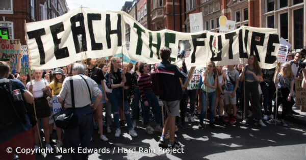 Protesting students holding a Teach The Future banner. Image by Mark Edwards