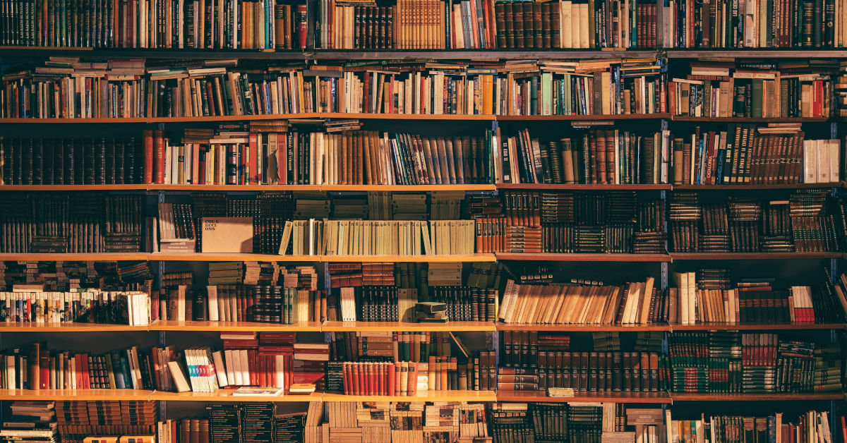 Shelves of books by by Alfons Morales on Unsplash
