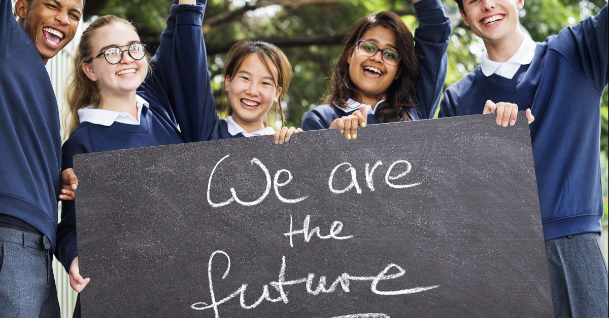 Students holding a blackboard saying We are the future. Image by Gerd Altmann from Pixabay