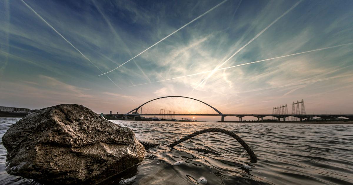 Contrails in the sky by Tijs van Leur on Unsplash