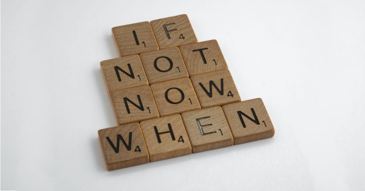 Scrabble tiles reading If not now when by Brett Jordan on Unsplash