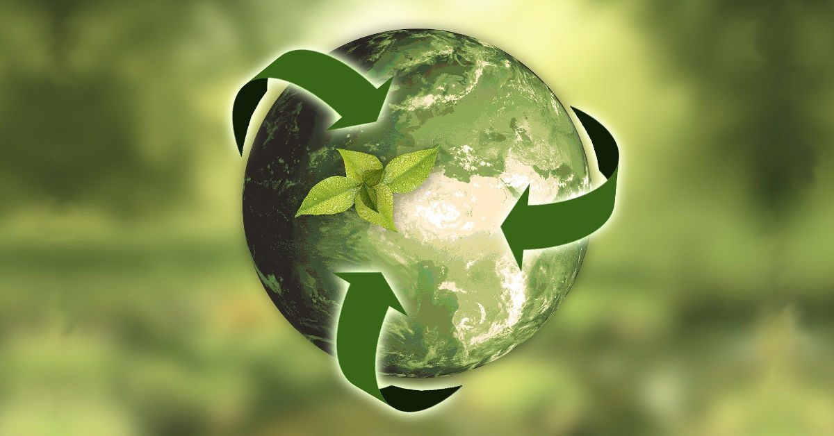 A green Earth from space with recycling symbol
