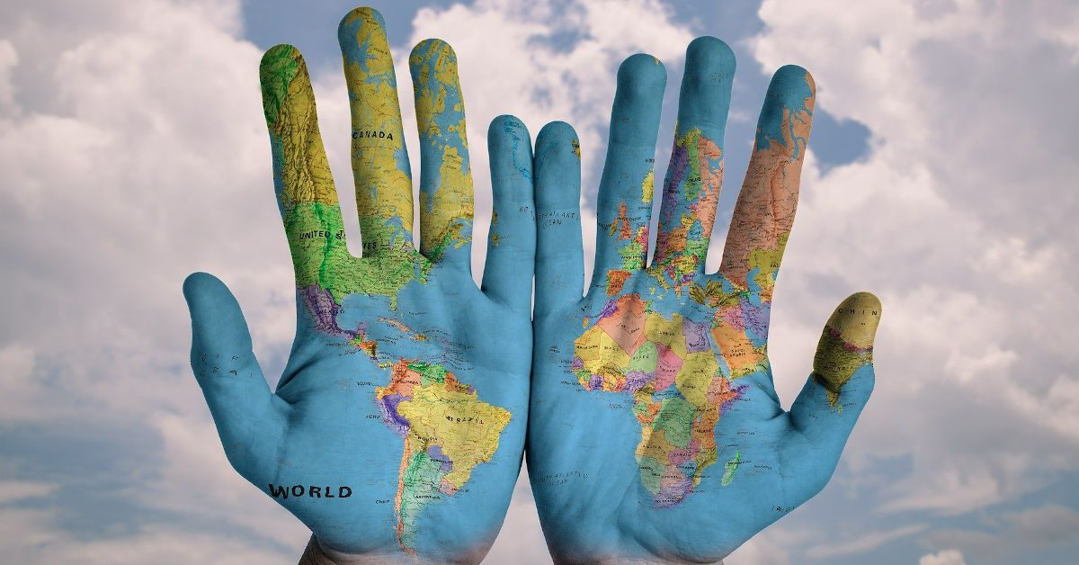 Hands painted with a map of the world Image by stokpic from Pixabay